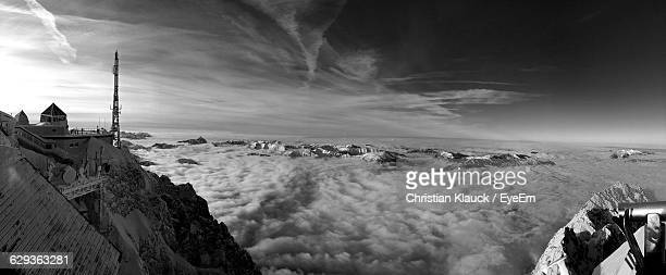 Idyllic Shot Of Clouds Over Snowcapped Mountains Seen From Zugspitze Against Sky