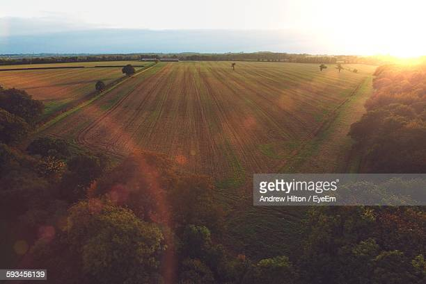 idyllic shot of farm field against sky - milton keynes stock photos and pictures