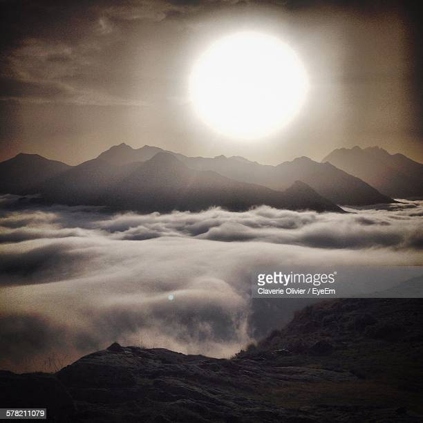 Idyllic Shot Of Foggy Mountain Range Against Sunset Sky