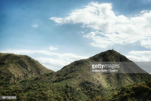 idyllic shot of green mountains against sky - andres ruffo stock-fotos und bilder