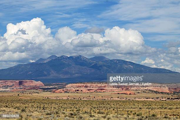 Idyllic Shot Of Landscape And Mountains Against Cloudy Sky