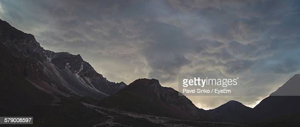 Idyllic Shot Of Mountains Against Cloudy Sky