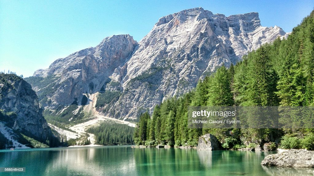 Idyllic Shot Of Pragser Wildsee By Rocky Mountains Against Sky : Stock Photo