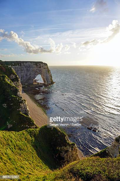 Idyllic Shot Of Rock Formation At Sea Against Sky In Etretat