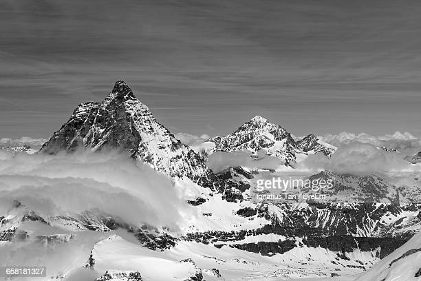 idyllic shot of swiss alps against sky - ignatius tan stock photos and pictures