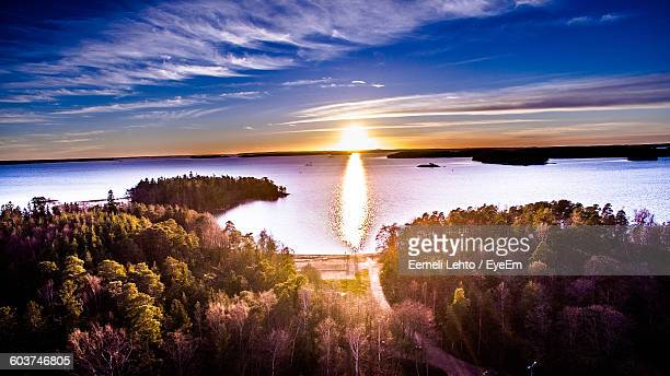 idyllic shot of trees and sea against sky during sunset - turku finland stock photos and pictures