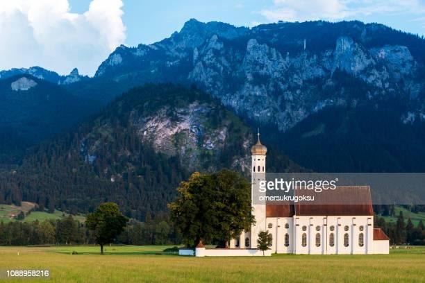 Idyllic St Coloman Church in Allgau, Bavarian Alps at summer, Germany