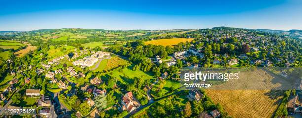 idyllic summer countryside picturesque village green farms fields aerial panorama - overhemd en stropdas stock pictures, royalty-free photos & images