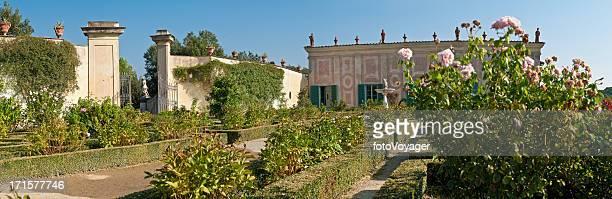 Idyllic summer gardens pink roses traditional Tuscan villa Florence Italy