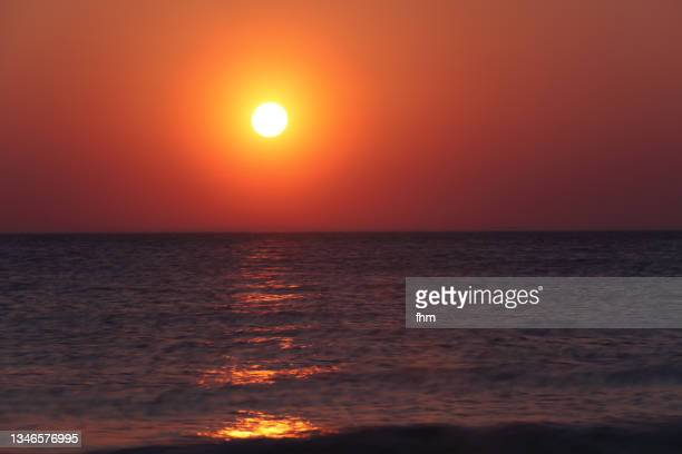 idyllic sunset at baltic sea - dunes arena stock pictures, royalty-free photos & images