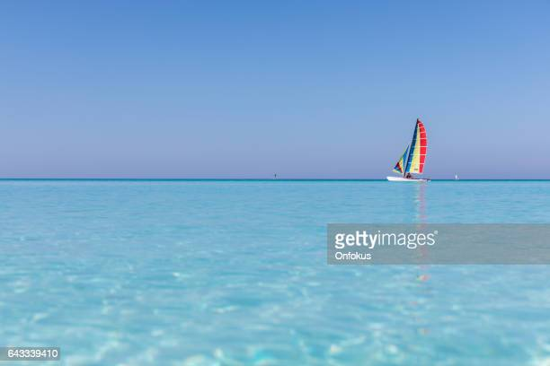 idyllic tropical sand beach, cayo coco, cuba - catamaran sailing stock photos and pictures