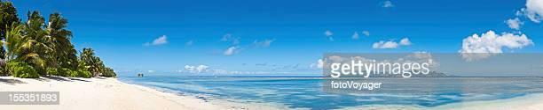 Idyllic vacation beach white sands tropical island blue lagoon