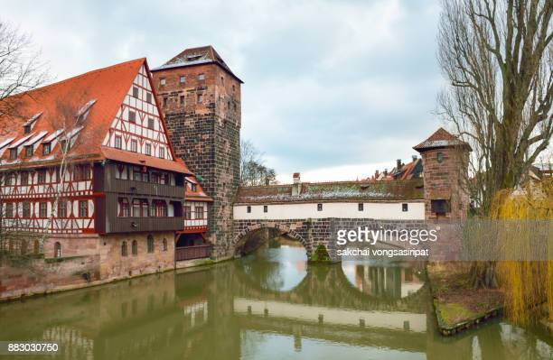 Idyllic View at Half-Timbered House and Henkersteg Tower, Nuremberg, Germany.