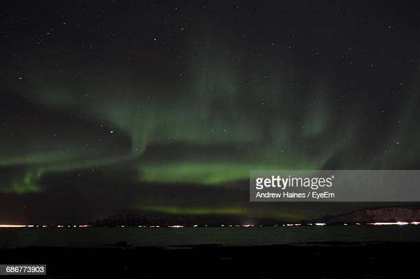 Idyllic View Of Aurora Borealis Over River At Night