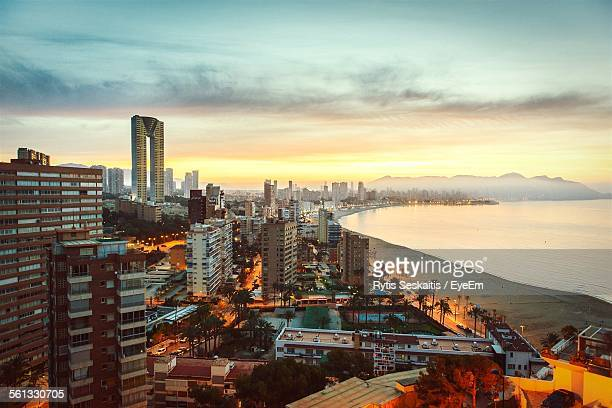 Idyllic View Of Benidorm Against Cloudy Sky During Sunset