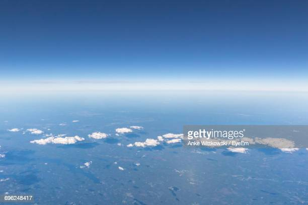 Idyllic View Of Clouds Over Landscape Against Blue Sky