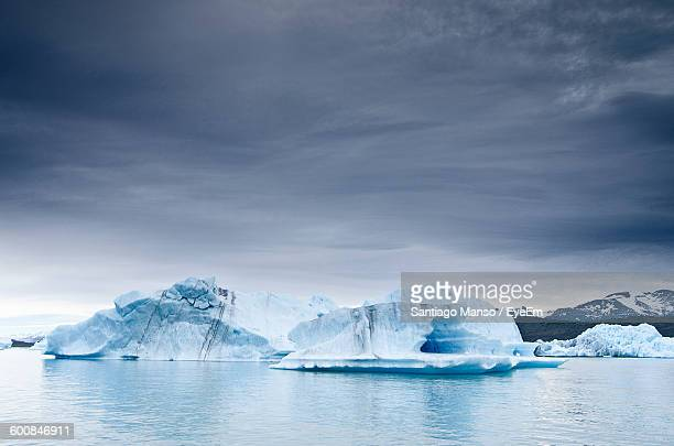Idyllic View Of Glacier By Lake Against Sky