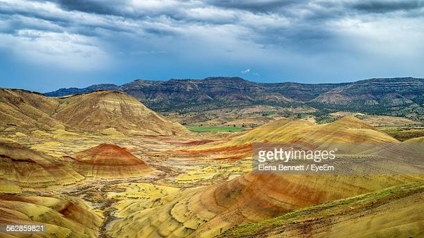 idyllic view of landscape at painted hills against cloudy sky - painted hills stock pictures, royalty-free photos & images
