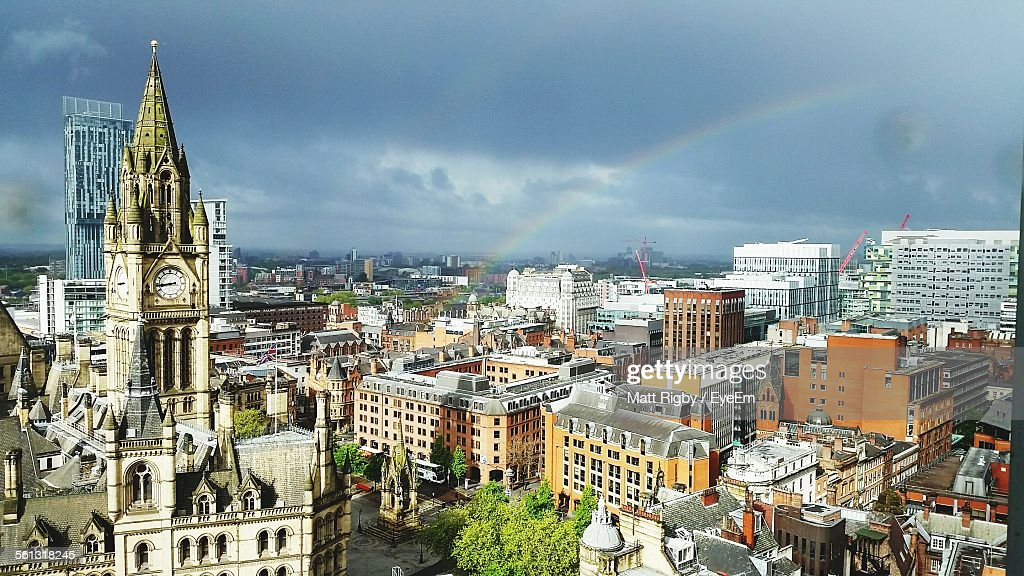 Idyllic View Of Rainbow Over Cityscape Against Cloudy Sky Seen From Chancery Place : Stock Photo