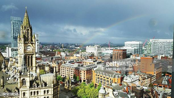 idyllic view of rainbow over cityscape against cloudy sky seen from chancery place - manchester england stock pictures, royalty-free photos & images
