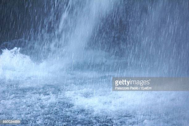 idyllic view of rainfall in sea - torrential rain stock pictures, royalty-free photos & images