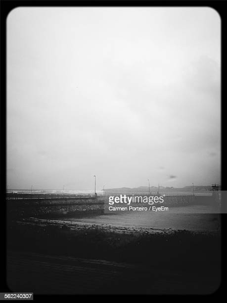 Idyllic View Of Rainy Day On Jetty Against Overcast Sky