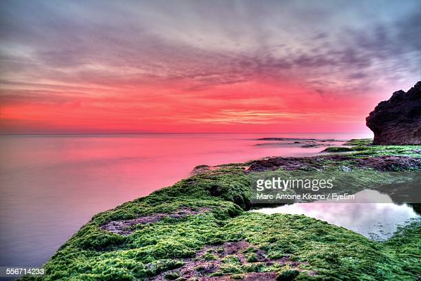 Idyllic View Of Sea Against Sky During Sunset