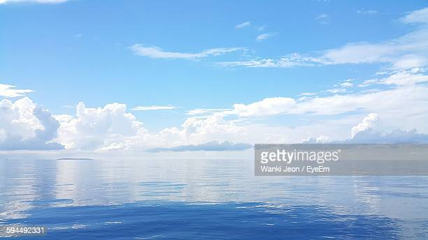 Idyllic View Of Seascape Against Cloudy Sky