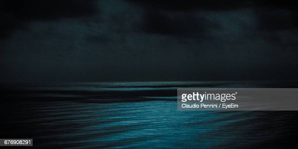 Idyllic View Of Seascape Against Stormy Sky At Night
