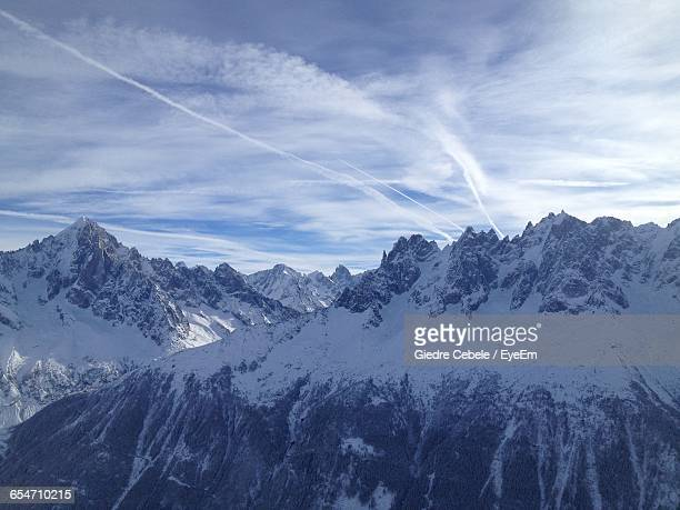 Idyllic View Of Snowcapped Mountains Against Sky