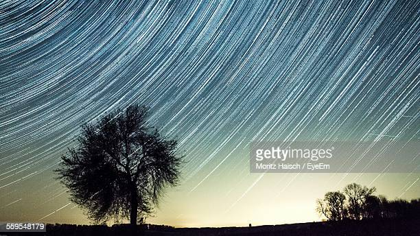 Idyllic View Of Star Trails At Night