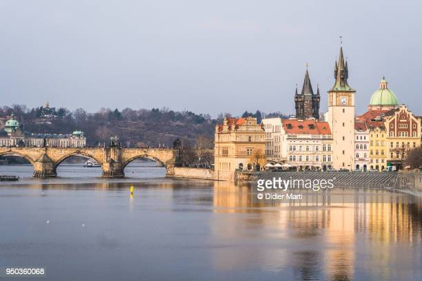 idyllic view of the famous charles bridges and prague old town - didier marti stock photos and pictures