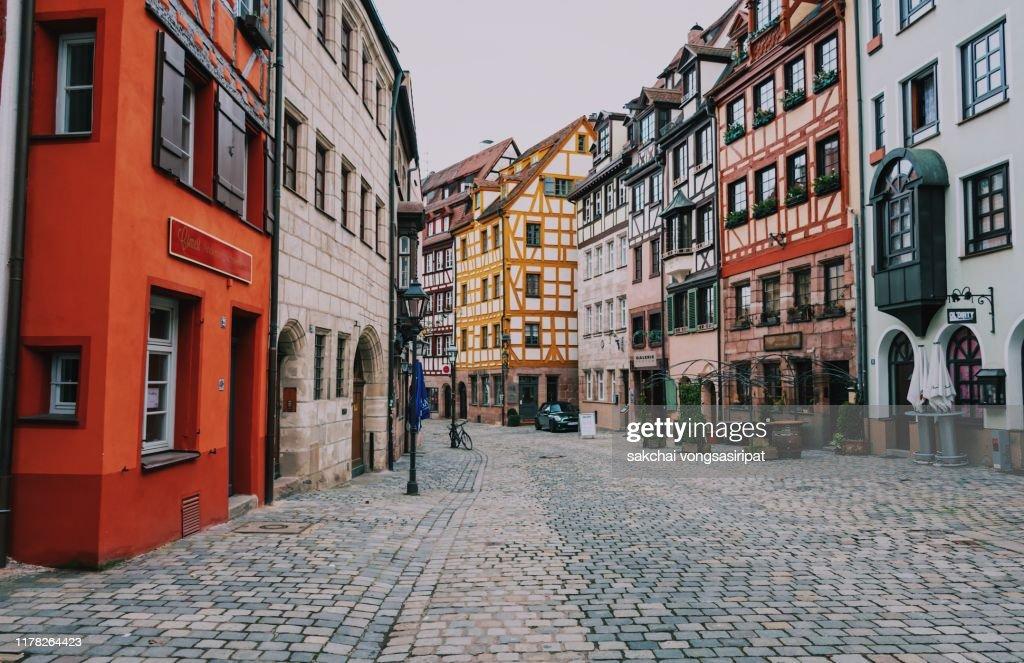 Idyllic Viewof Row houses on street, Weissgerbergasse in Nuremberg City, Germany : Stock Photo