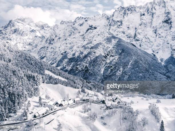 idyllic winter landscape from above - slovenia stock pictures, royalty-free photos & images