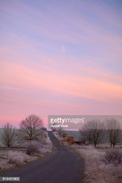 Idyllic winter scenery with frost and dramatic sky, dawn (daybreak)