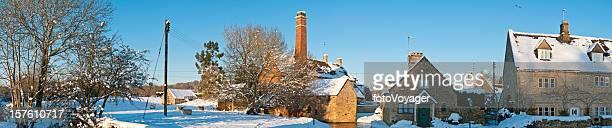 idyllic winter village cottages watermill crisp white snow Cotswolds UK