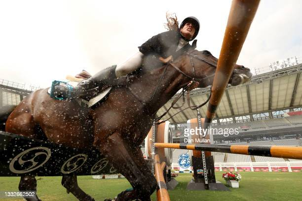 Ieda Guimaraes of Team Brazil riding Caleansiena YH falls at a jump in the Riding Show Jumping of the Women's Modern Pentathlon on day fourteen of...