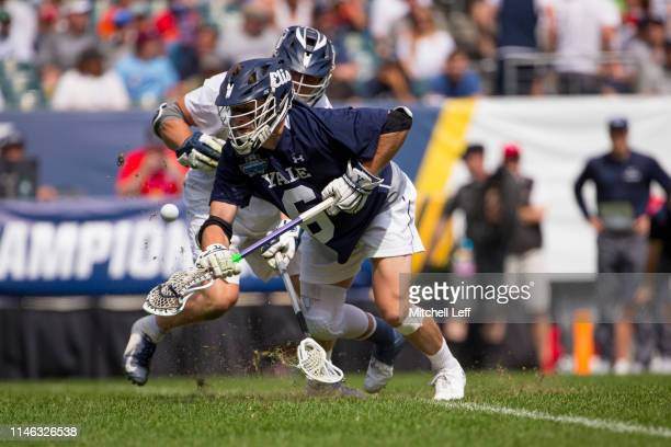 Ierlan of Yale Bulldogs wins a faceoff against Gerard Arceri of Penn State Nittany Lions in the first quarter of the 2019 NCAA Division I Men's...