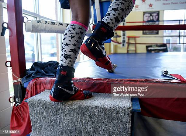 Iesha Kenney a junior at TC Williams HS sports her fancy socks as she climbs into the ring at the Alexandria Boxing Club during her workout on April...