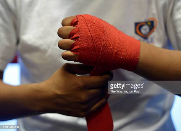 Iesha Kenney a junior at TC Williams HS wraps her hands prior to her work out at the Alexandria Boxing Club on April 2 2015 in Alexandria VA