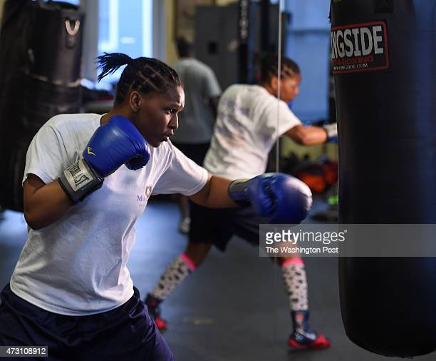 Iesha Kenney hits the body bag during her work out at the Alexandria Boxing Club on April 2 2015 in Alexandria VA