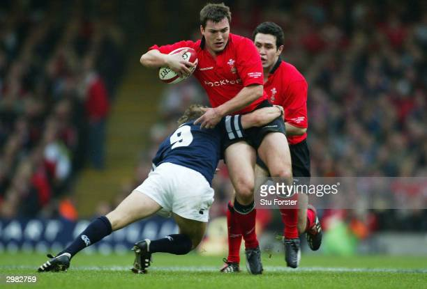 Iestyn Harris of Wales tries to get past Chris Cusiter of Scotlnd during the RBS 2004 Six Nations match between Wales and Scotland at The Millennium...