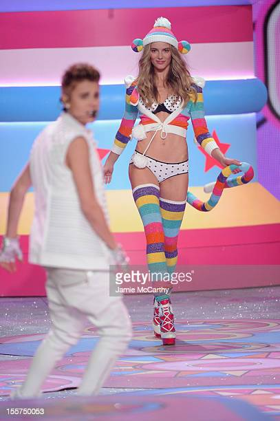 Ieva Laguna walks the runway while Justin Bieber performs onstage during the 2012 Victoria's Secret Fashion Show at the Lexington Avenue Armory on...