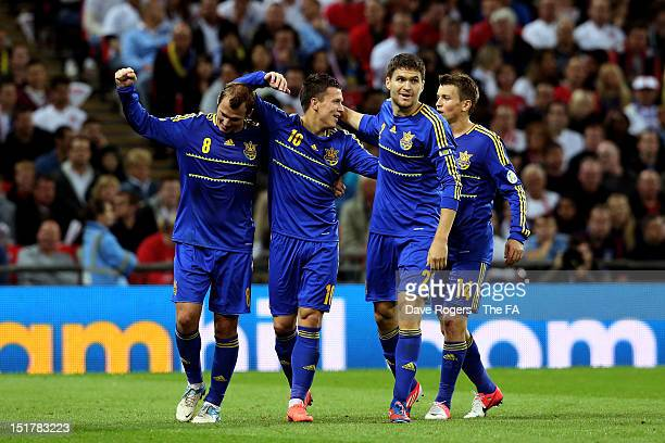Ievgenii Konoplianka of Ukraine celebrates with teqammates after scoring the opening goal during the FIFA 2014 World Cup qualifier group H match...
