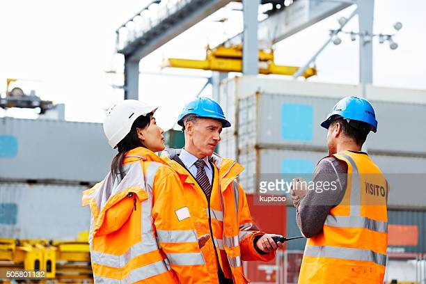 if it needs moving, they're your team - longshoremen stock pictures, royalty-free photos & images