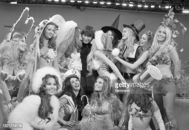 If you look closely you can see Joe Namath, of the New York Jets, in the center of twelve Playboy Playmates. Namath and the women appeared on the...