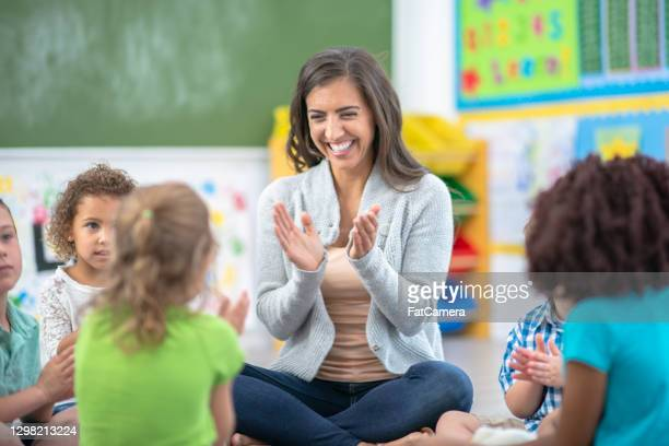 if you're happy and you know it, clap your hands - montessori education stock pictures, royalty-free photos & images