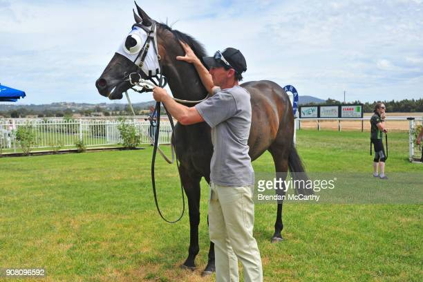 Ifaconican with strapper and owner Jon Hassall after winning the njt20cricketcomau Maiden Plate at Ararat Racecourse on January 21 2018 in Ararat...