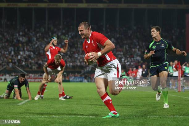 Ifan Evans of Wales scores a try during the Wales v Australia match on Day Two of the IRB Dubai Sevens at the Sevens Stadium on December 2 2011 in...