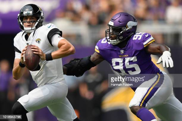 Ifeadi Odenigbo of the Minnesota Vikings gives chase to Cody Kessler of the Jacksonville Jaguars during the fourth quarter in the preseason game on...